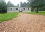 Foreclosed Home in Liberty 77575 711 BAKER CIR - Property ID: 4018198